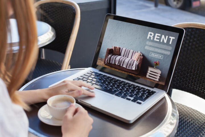 rent online concept, woman using internet website for rental apartments, houses and flats